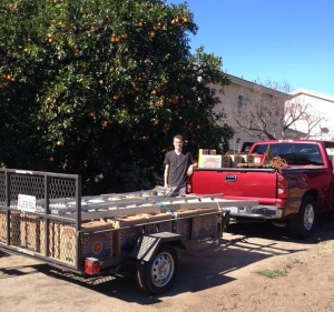 Jackson takes a breather after loading up this 1,000-pound load of fruit.